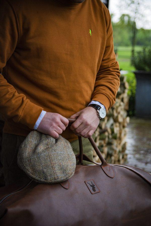 Koedoe & Co jacht trui sweater dark driven orange detail athmosphere